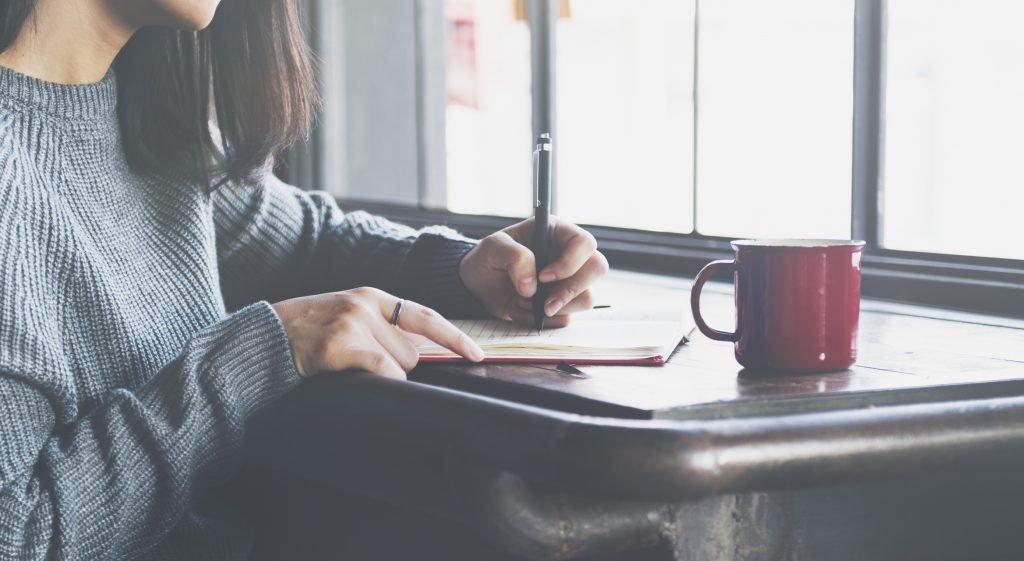 Lady Writing Notebook