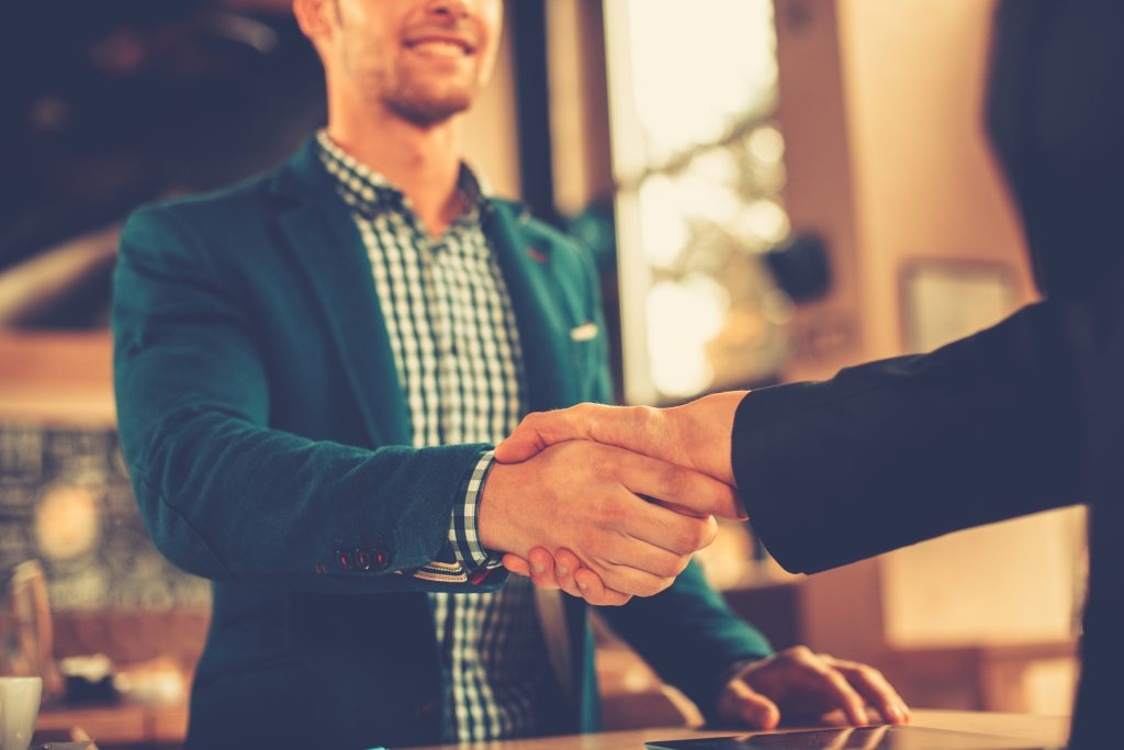 Men shaking hands after job interview