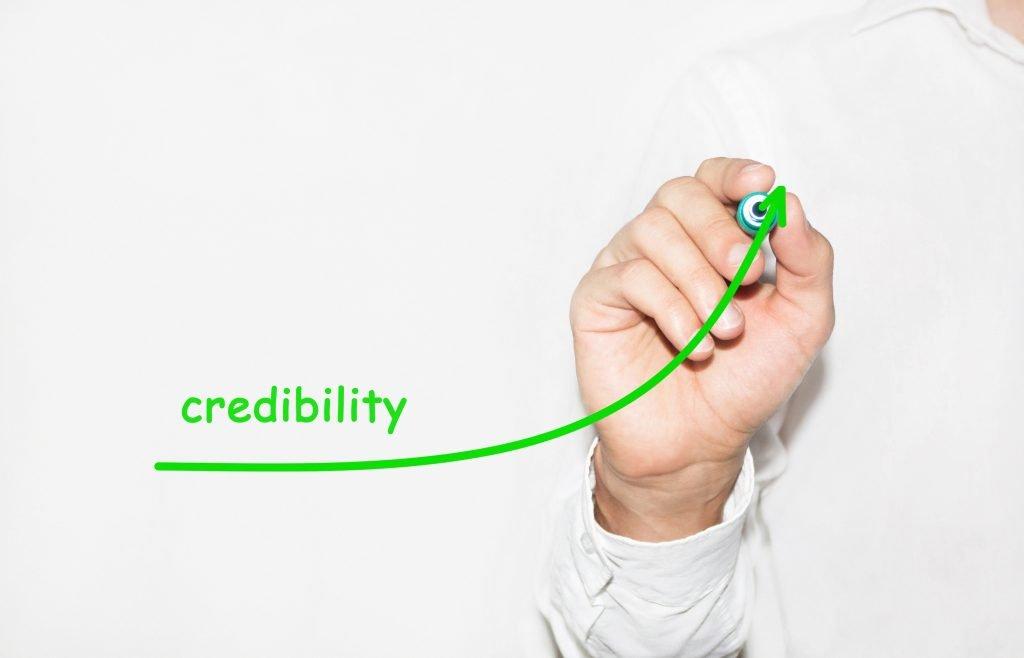Businessman whiteboarding a credibility graph